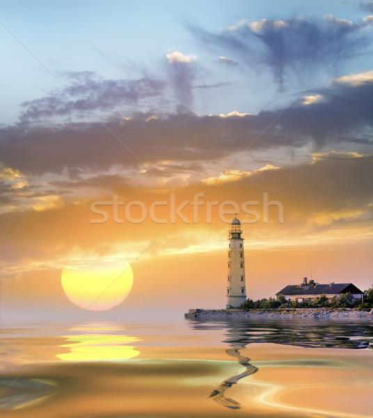 Faro playa cielo sol luz mar Foto stock © tycoon