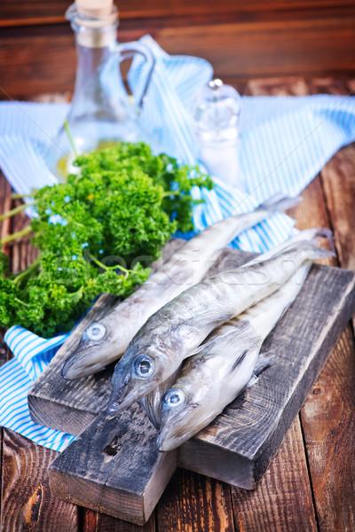 Сток-фото: сырой · рыбы · таблице · ножом · лимона