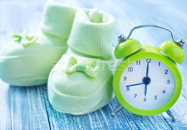 clock and baby socks Stock photo © tycoon
