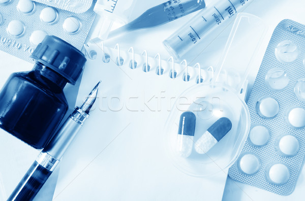 note and pills Stock photo © tycoon