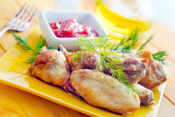 Hot Meat Dishes - Grilled Chicken Wings with Red Spicy Sauce Stock photo © tycoon