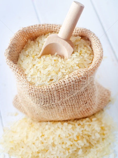 Raw rice on the table, portion of the raw rice Stock photo © tycoon