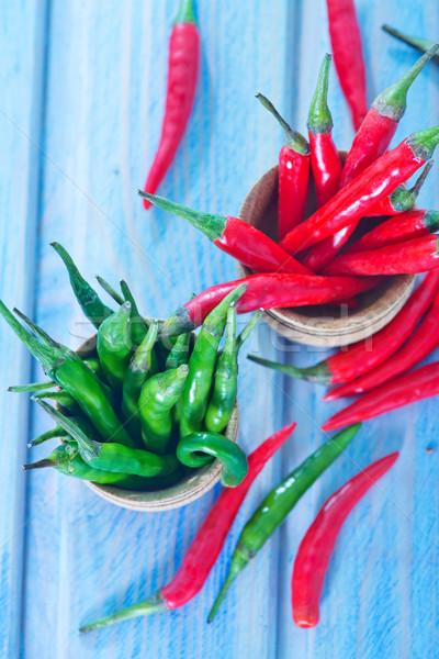 Chilli zöld piros paprikák asztal természet Stock fotó © tycoon