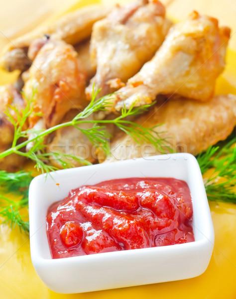 Sıcak et bulaşık ızgara tavuk kanatlar kırmızı Stok fotoğraf © tycoon