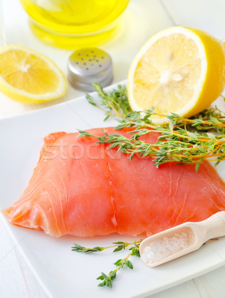 Raw salmon on the white plate with thyme and salt Stock photo © tycoon