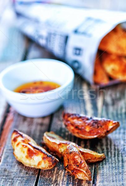 Hal sültkrumpli fa asztal papír újság nyár Stock fotó © tycoon