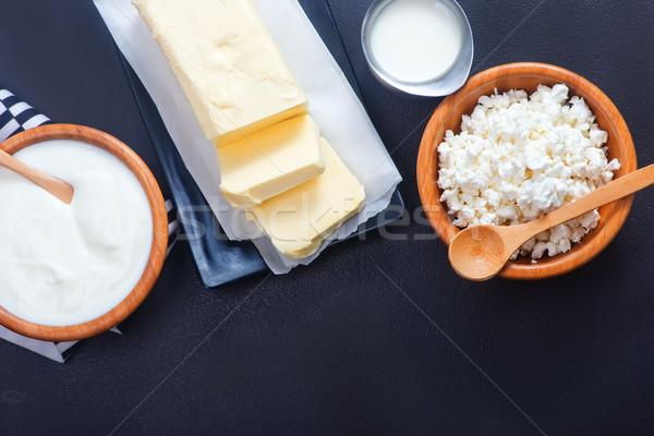 Latte prodotti nero tavola burro sfondo Foto d'archivio © tycoon