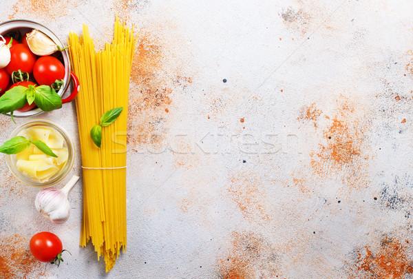 Nyers spagetti sajt friss paradicsom terv Stock fotó © tycoon