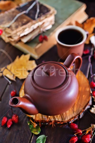 Fresco chá bule tabela livro Foto stock © tycoon