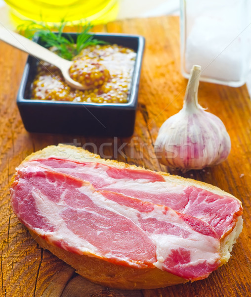 Bread with bacon on the wooden board Stock photo © tycoon