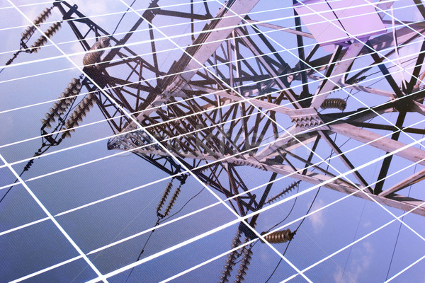 transmission tower reflected in solar panel Stock photo © ultrapro