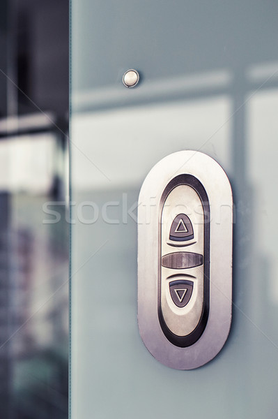 Elevator button. On modern glass wall Stock photo © ultrapro
