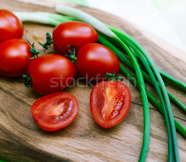 red tomatoes and green onions on the cutting board Stock photo © ultrapro