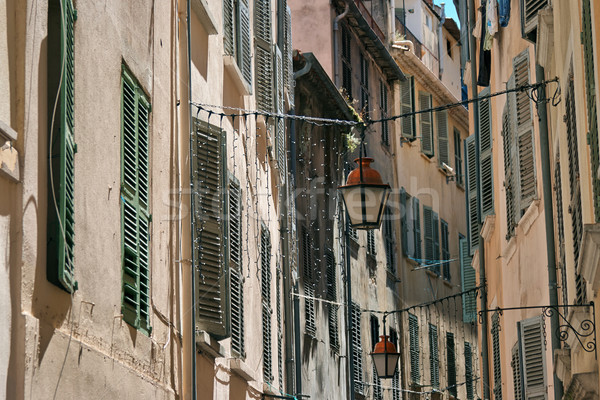 Lanterns hanging on a narrow street of the old French town Stock photo © ultrapro