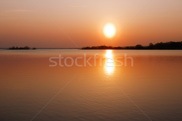 Lake in light of the setting sun Stock photo © ultrapro