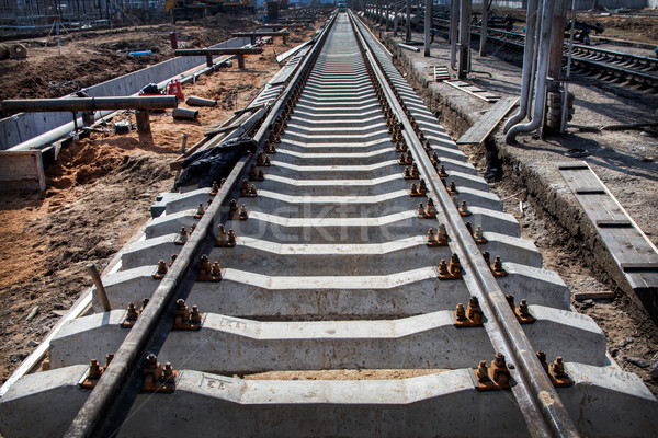 Perspective view of Concrete railroad ties in railway constructi Stock photo © ultrapro
