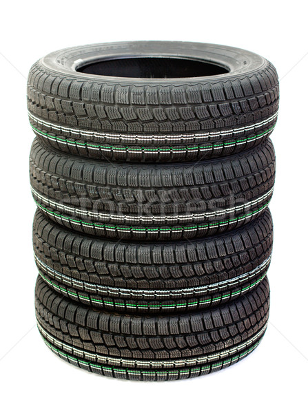Four new tires stacked on white background Stock photo © ultrapro