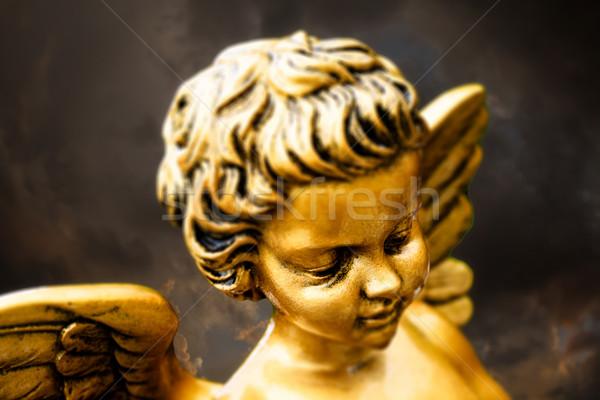Mały złoty cherub metal religii wiary Zdjęcia stock © umbertoleporini