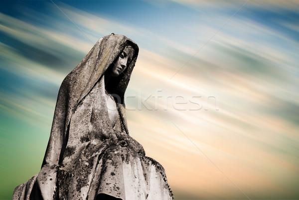 Maagd grafsteen zonsondergang hemel gezicht jesus Stockfoto © umbertoleporini