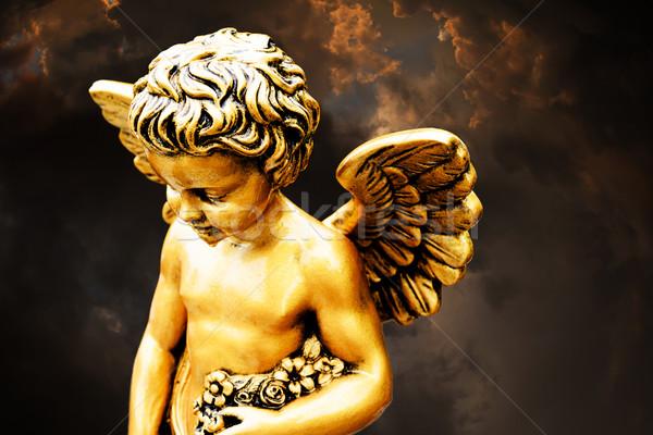 Mały złoty cherub metal wiary religijnych Zdjęcia stock © umbertoleporini