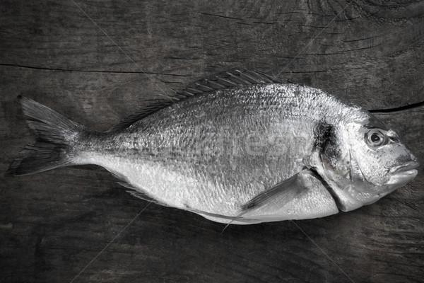 морем подготовка деревянный стол черно белые фото рыбы Сток-фото © umbertoleporini