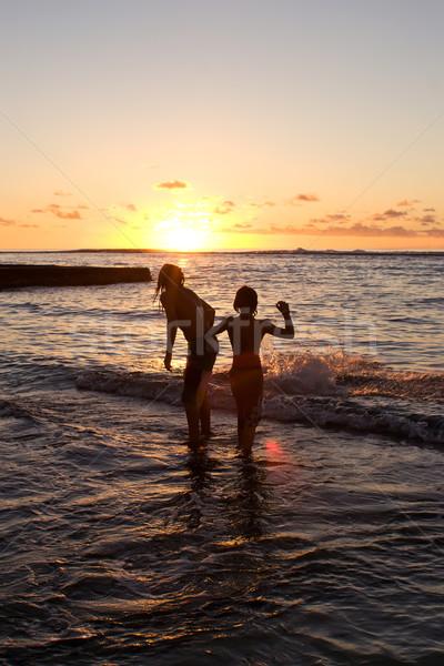 Sunset swim Stock photo © Undy
