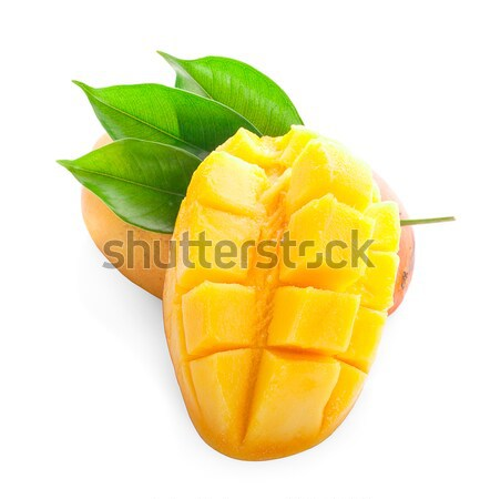Mango fruit with mango cubes and slices. Isolated on a white bac Stock photo © ungpaoman