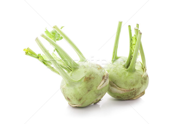 Fresh kohlrabi with green leaves on isolated white backround Stock photo © ungpaoman