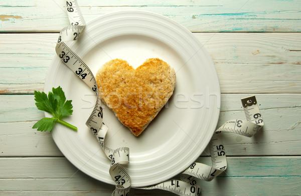 Brindis forma de corazón placa cinta métrica alimentos Foto stock © unikpix