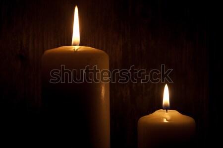 Lit candles in the dark  Stock photo © unikpix