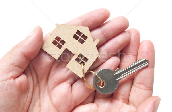 Miniatűr ház kulcs kezek tart csatolva Stock fotó © unikpix