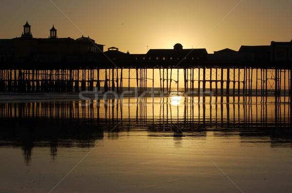 Playa muelle agua sol puesta de sol mar Foto stock © unikpix