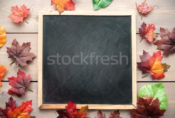 Autumn leaves around a blackboard  Stock photo © unikpix