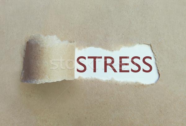 Torn paper uncovering stress Stock photo © unikpix