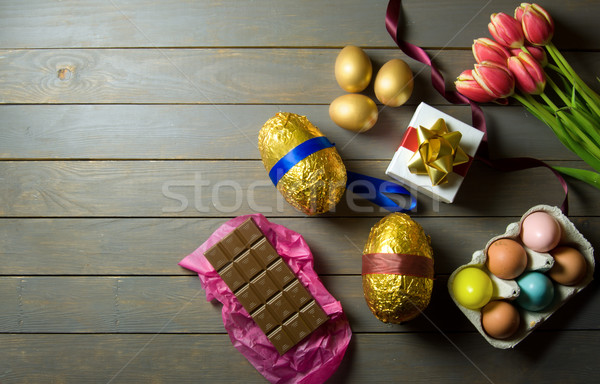 Easter eggs on wooden background Stock photo © unikpix