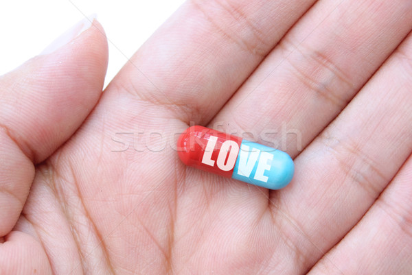 Amour dose main capsule pilule Photo stock © unikpix