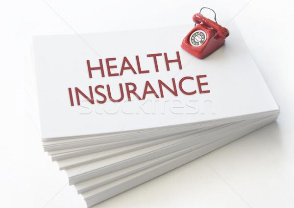 Seguro de saúde cartão de visita pequeno telefone topo Foto stock © unikpix