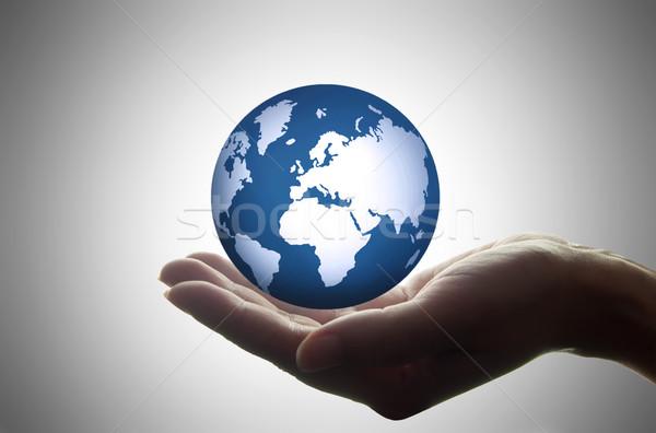 Kéz tart földgömb atlasz kezek világ Stock fotó © unikpix