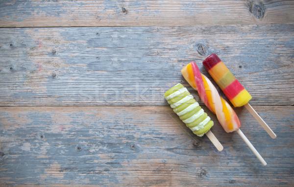 Ice lollies on a wooden backgroud Stock photo © unikpix