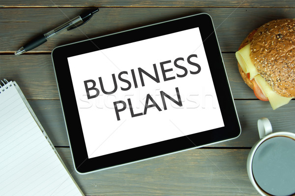 Business plan computer tablet scherm financieren Stockfoto © unikpix
