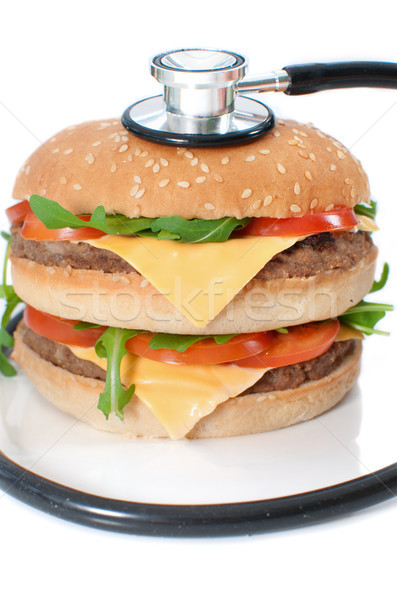 Malsain Burger stéthoscope autour doubler cheeseburger Photo stock © unikpix