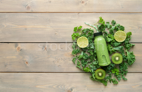 Smoothie vert bouteille table en bois ingrédients fruits Photo stock © unikpix
