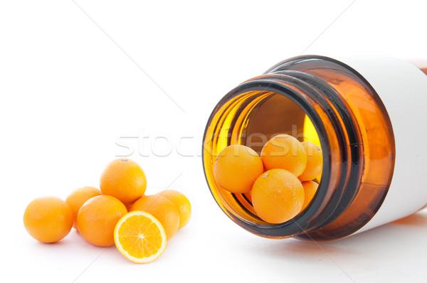 витамин С миниатюрный апельсинов внутри контейнера Сток-фото © unikpix
