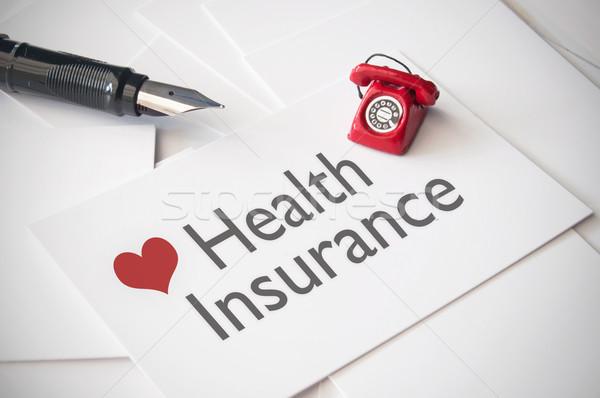 Seguro de saúde pequeno telefone topo cartão de visita coração Foto stock © unikpix