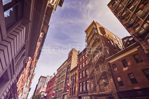 Old apartment buildings and fire escapes Stock photo © unkreatives