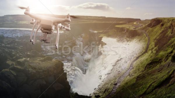 Drone flying over icelandic Waterfall Gulfoss Stock photo © unkreatives