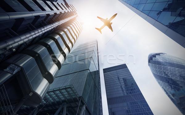 Avião múltiplo escritório torres voador high-rise Foto stock © unkreatives