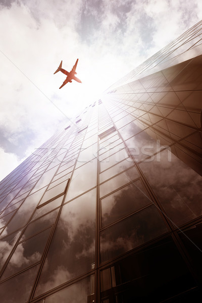 Frankfurt Skyscraper with plane Stock photo © unkreatives