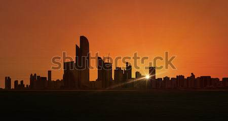 Abu Dhabi sziluett városkép Egyesült Arab Emírségek körül üzlet Stock fotó © unkreatives