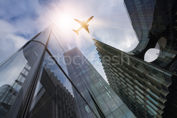 plane over highrise buildings Stock photo © unkreatives